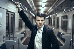 Guy in the subway car. Guy in an empty subway car, he`s sad with loneliness Royalty Free Stock Photos