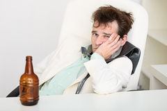 Guy is suffering from hangover Royalty Free Stock Image