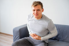 Guy suffering from a stomachache Royalty Free Stock Image