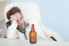 Guy suffers from hangover - beer Royalty Free Stock Photo