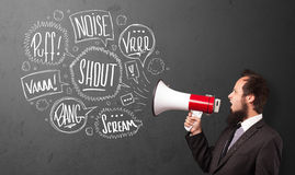 Guy in suit yelling into megaphone and hand drawn speech bubbles Stock Image