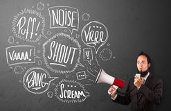 Guy in suit yelling into megaphone and hand drawn speech bubbles Royalty Free Stock Photo