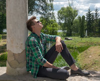 Guy in sunglasses relaxing in nature Royalty Free Stock Images