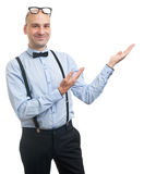 Guy with suspenders and bow-tie showing copy space Royalty Free Stock Images