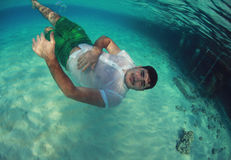 Guy swimming in the ocean Stock Photography