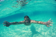 Guy swimming in the oceans sea, Maldives Royalty Free Stock Photography