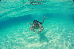 Guy swimming in the oceans sea, Maldives Stock Photography