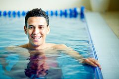 Guy in swimming pool Royalty Free Stock Photography