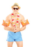 Guy in a swimsuit with swimming arm bands Royalty Free Stock Images