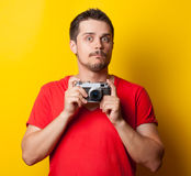 Guy in t-shirt with retro camera Royalty Free Stock Photos
