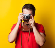 Guy in t-shirt with retro camera Stock Image