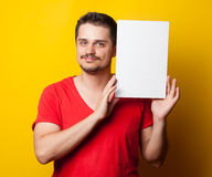 Guy in t-shirt with white board Royalty Free Stock Photography