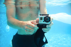 Guy take pictures underwater in the pool Royalty Free Stock Photography