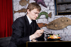 The guy takes sushi Royalty Free Stock Image