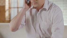 Guy talking over mobile phone and finishing call, making appointment, healthcare