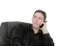 Guy talking on phone. Businessman talking on phone over white Stock Image