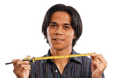 Guy with a Tape Measure Royalty Free Stock Photo