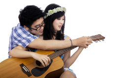 Guy teach his girlfriend to play guitar Stock Photo