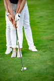 Guy teaching his girlfriend to play golf royalty free stock photos