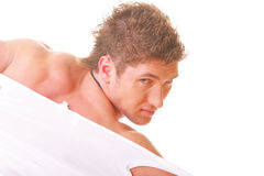 Guy tearing shirt. Rear view photo against white background Stock Images