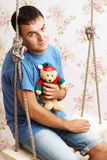 Guy with teddy bear in his hands Stock Image