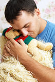 Guy with teddy bear in his hands Royalty Free Stock Images