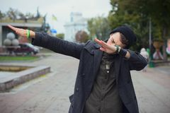 Guy teen walking around the city. Shows success gesture Stock Photos