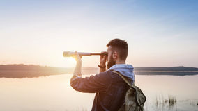 A guy with a telescope for nature... Guy with a telescope on nature sunset sun Royalty Free Stock Image