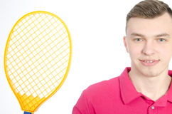 Guy with a tennis racket. Royalty Free Stock Photo