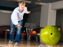 Young man playing bowling Royalty Free Stock Image