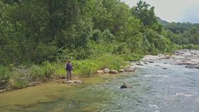 Guy Throws Fishing Net into River Tries to Pull out stock video