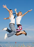 Guy in tie and slim girl jumping Royalty Free Stock Images