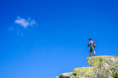 Guy on the top of a boulder Stock Photo