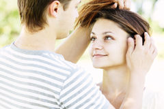 Guy touching girlfriends hairs Stock Image