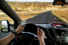 Guy tourist driving a car in the mountains, traveling to Iceland stock images