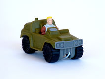 Guy Toy. Image of a toy man driving a toy military vehicle Stock Photos