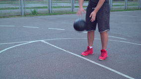 Guy training dribble at the sports ground stock video footage