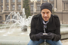 Guy On Traveling With Mobile Phone And Hat In City, Urban Space Stock Photography
