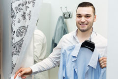 Guy trying on new shirt Stock Image