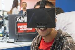 Guy trying Oculus headset at Games Week 2014 in Milan, Italy Royalty Free Stock Image