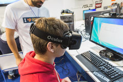 Guy trying Oculus headset at Games Week 2014 in Milan, Italy Stock Images