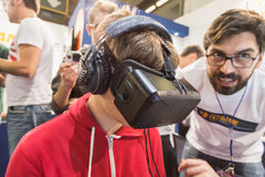 Guy trying Oculus headset at Games Week 2014 in Milan, Italy Royalty Free Stock Images