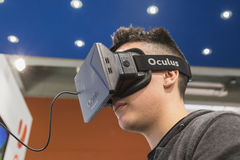 Guy trying Oculus headset at Games Week 2014 in Milan, Italy Stock Image