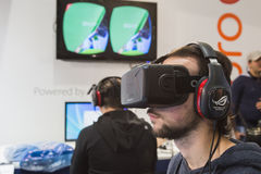 Guy trying Oculus headset at Games Week 2014 in Milan, Italy Stock Photography