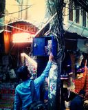 The guy trying to repair electrocity cable in the street of Old Delhi. Old Delhi corner stock photo