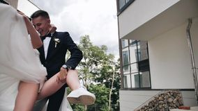 The guy turns his girlfriend in the dance, holding her in his arms. beautiful dance movement. stock footage