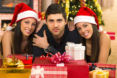 Guy and two beautiful twin girls on Christmas Royalty Free Stock Photo