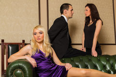 A guy and two girls in the room Stock Images