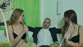 Guy and two girls smoke hookah stock video