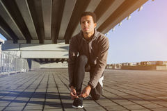 Guy tying shoe laces before a run royalty free stock images